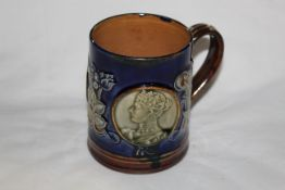 A Doulton Lambeth stoneware Edward VII coronation mug,
