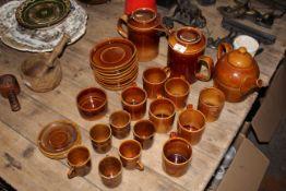 A Hoganas Swedish brown glazed stoneware part tea/coffee service comprising teapot,