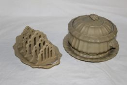 A 19th century pale green glazed pottery 4 division toast rack, of oval shaped outline,
