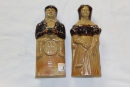 A pair of early 19th century brown two tone stone ware figural flasks,