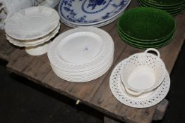 A quantity of reproduction Leeds cream ware pottery, comprising oval basket and stand,