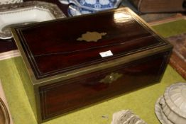 A 19th century brass bound mahogany writing box, with maroon leather lined writing slope,