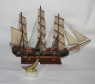 A scratch built painted wood model galleon on stand,