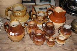 Ten 19th century two tone stoneware harvest jugs of various sizes including Doulton Lambeth.