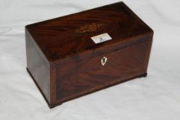 A George III figured mahogany rectangular tea caddy,