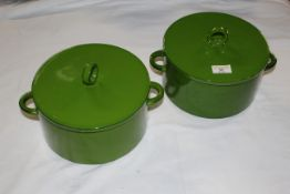 A pair of pea green glazed pottery lidded casserole dishes. 26 cm wide x 18 cm high.