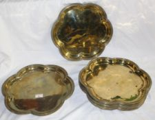 A Set of nine 19th century brass hexafoil chargers or salvers, of ecclesiastical design,