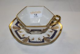 An early 20th century Limoges porcelain cabinet cup and saucer,