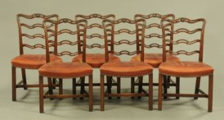 A set of six George III style mahogany ladder back dining chairs, with leather upholstered seats.