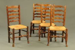 Four 19th century rush seated ladder back dining chairs.