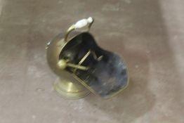 A late Victorian brass coal scuttle, hel
