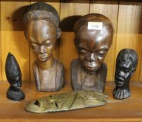 Two African hardwood carved busts. 24 cm