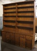 A large modern pine kitchen dresser. 24