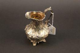 A Victorian embossed silver milk jug, wa