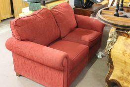 A modern red upholstered sofa bed/bed se