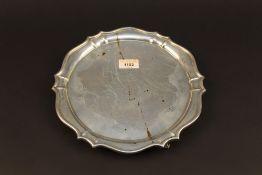 An Edwardian silver salver, of circular