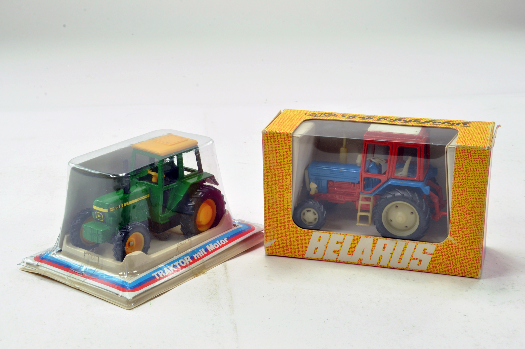 Lot 296 - Britains Friction Drive Export John Deere 3185 Tractor plus Scarce Belarus Blue / Red Coloured issue