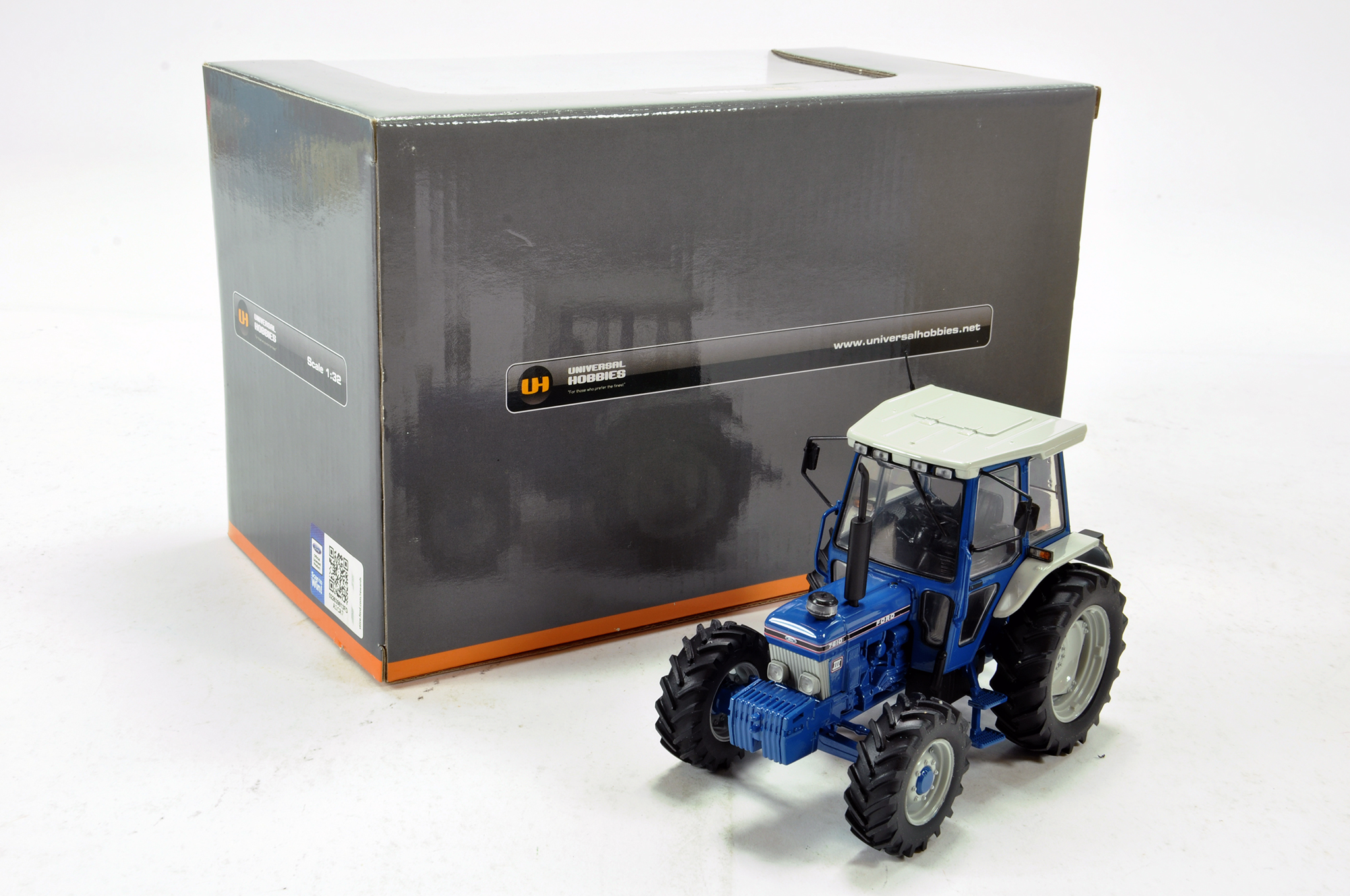 Lot 763 - Universal Hobbies 1/32 Ford 7610 Gen III Tractor. Excellent in Box.