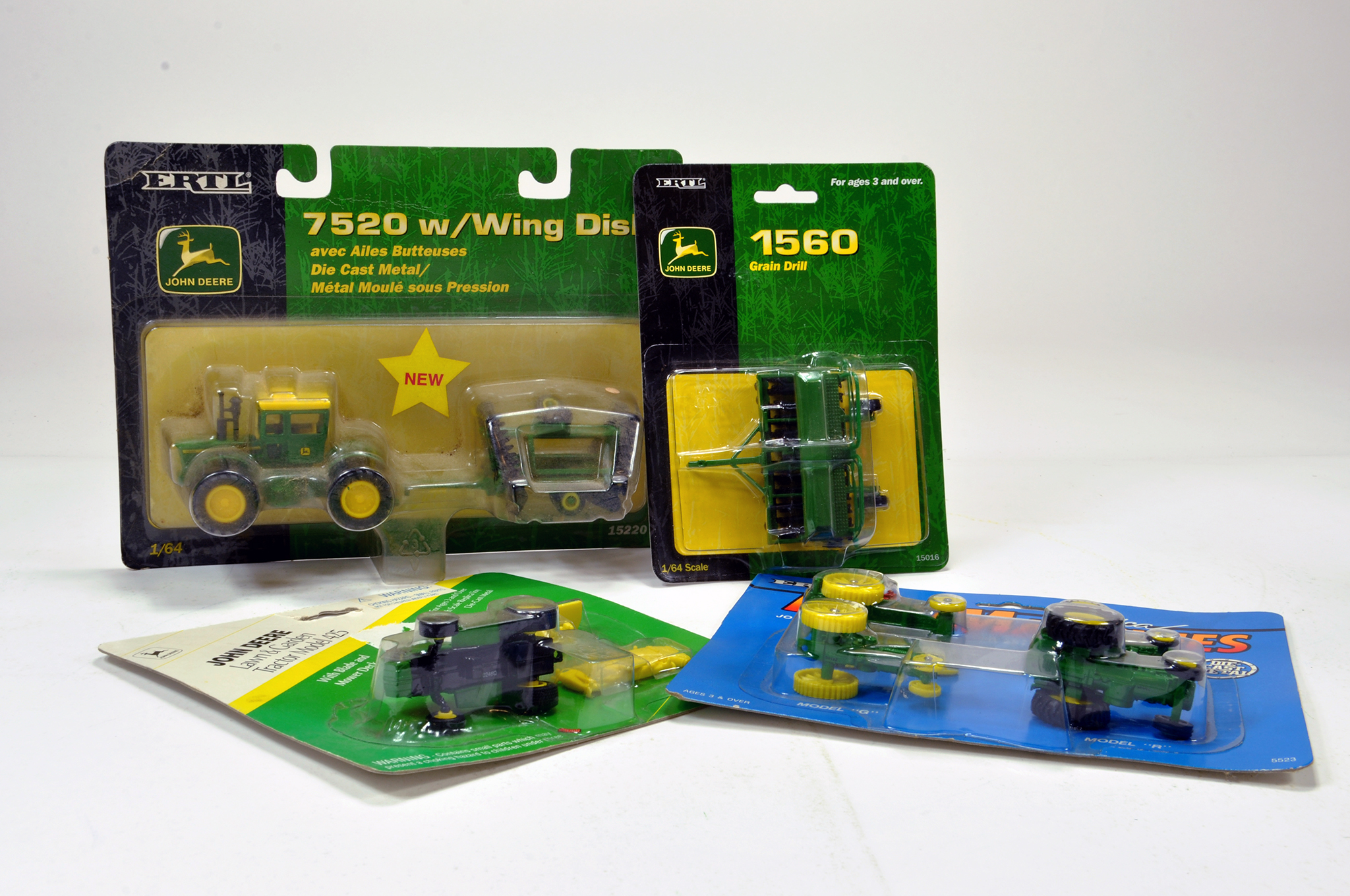 Lot 118 - Ertl 1/64 John Deere tractor and machinery group including 7520 tractor and others. Generally