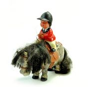 Rare Thelwell model pony and rider made by Plastech. Rider sports a red show jacket, riding hat,