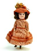 "Antique Bisque Mignonette Doll Marked 15 on back of head. 9"". Glass blue eyes, painted lashes,"