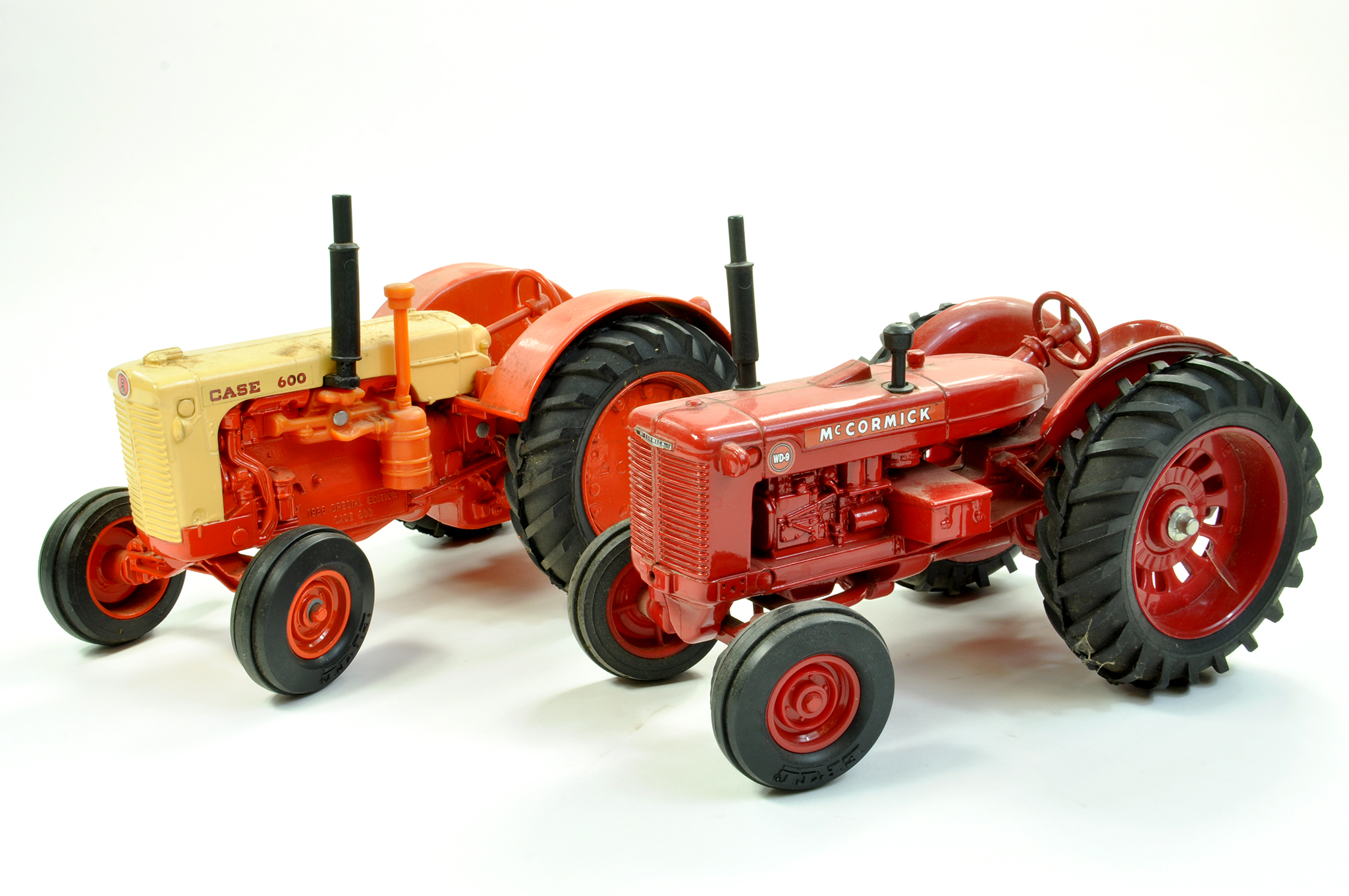 Lot 7 - Ertl 1/16 diecast farm issue duo comprising Case 600 Tractor plus McCormick WD-9. Generally