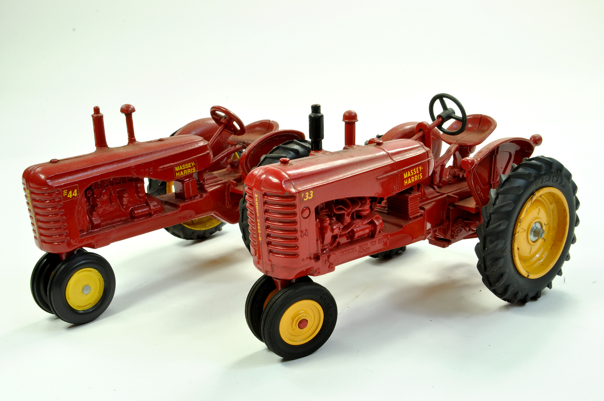 Lot 36 - Duo of Massey Harris Tractor issues in 1/16 comprising MH44 and MH33, Ertl. Generally Excellent.