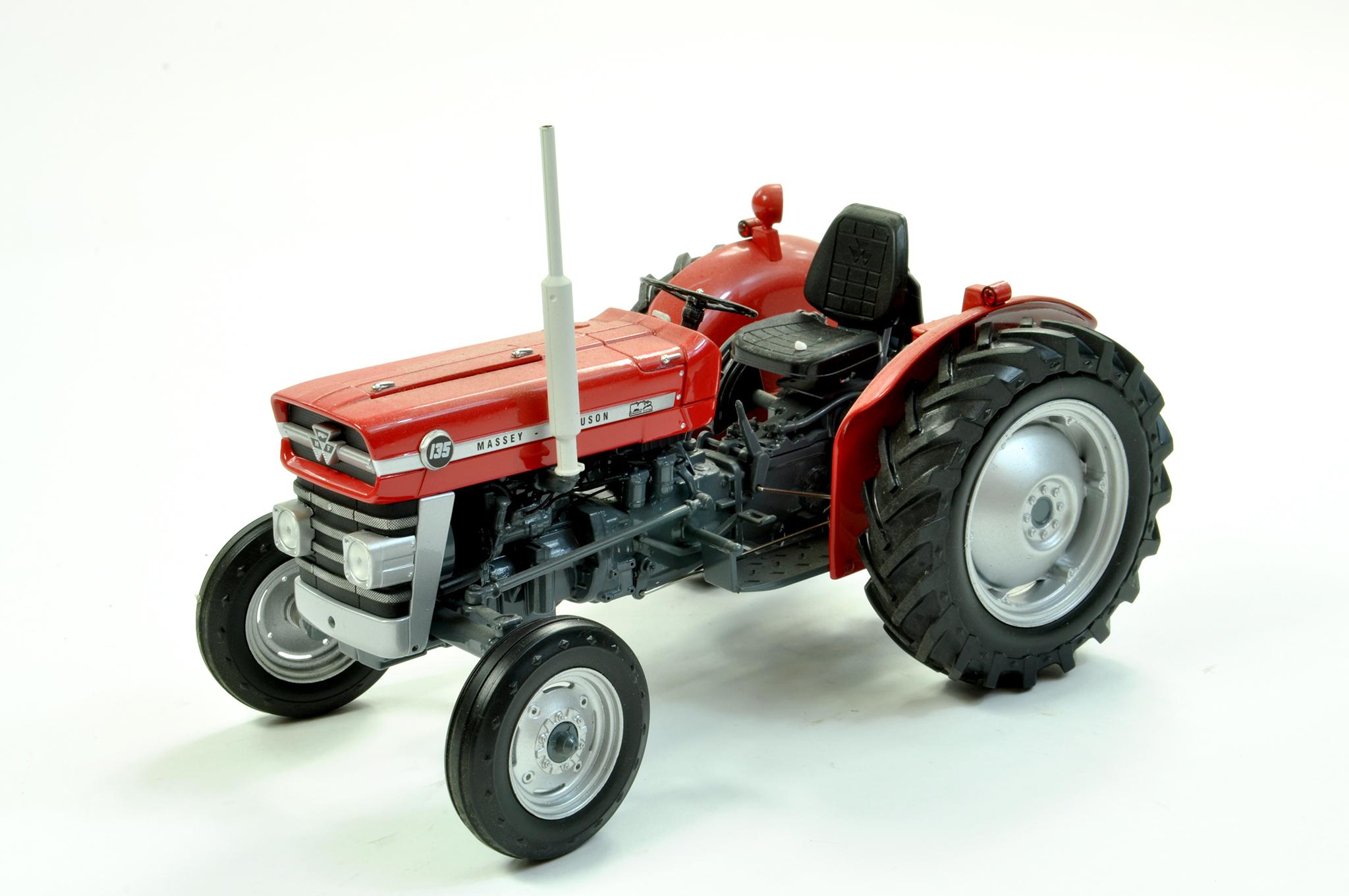 Lot 40 - Universal Hobbies 1/16 diecast farm issue comprising Massey Ferguson 135 Tractor. A little dusty but