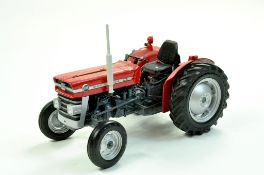 Universal Hobbies 1/16 diecast farm issue comprising Massey Ferguson 135 Tractor. A little dusty but