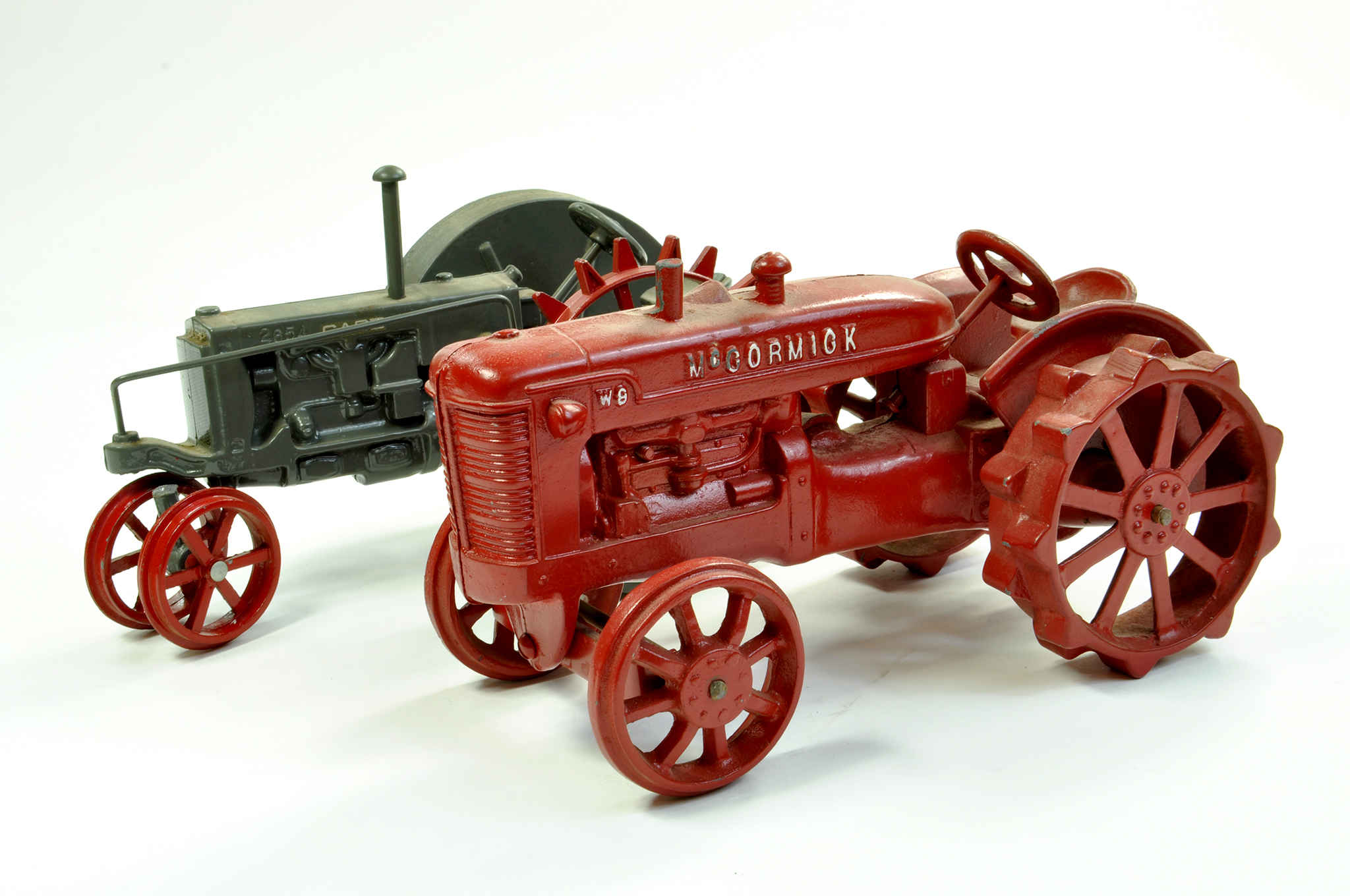 Lot 20 - Scale Models 1/16 Cast McCormick W9 Tractor plus Scale Models issue of a Case tractor on Row