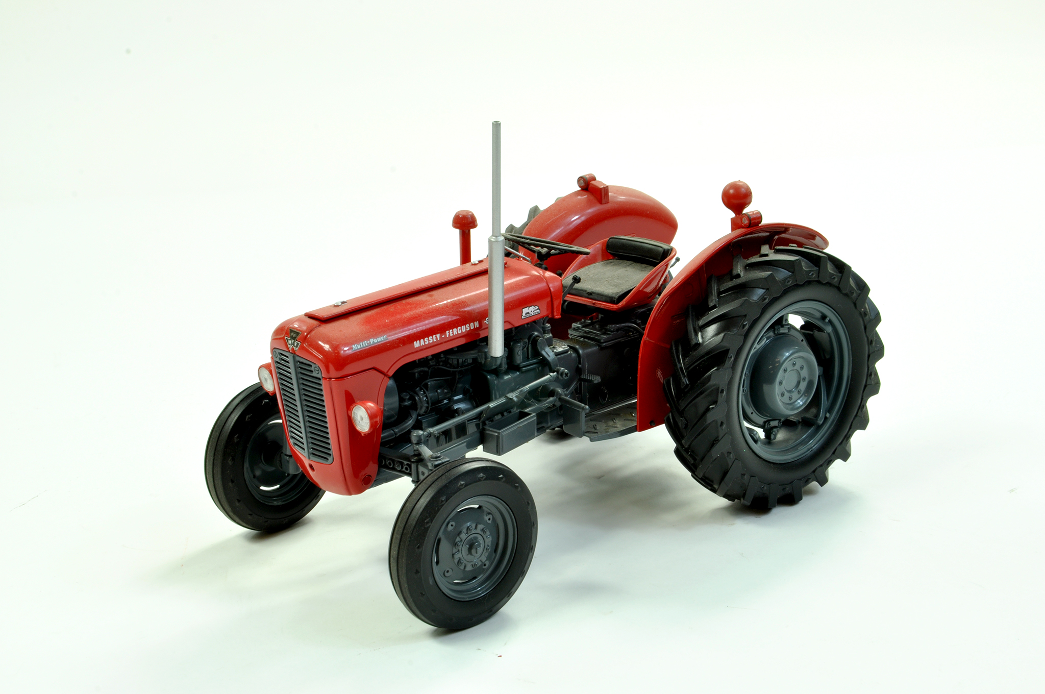 Lot 42 - Universal Hobbies 1/16 diecast farm issue comprising Massey Ferguson 35X Tractor. A little dusty but