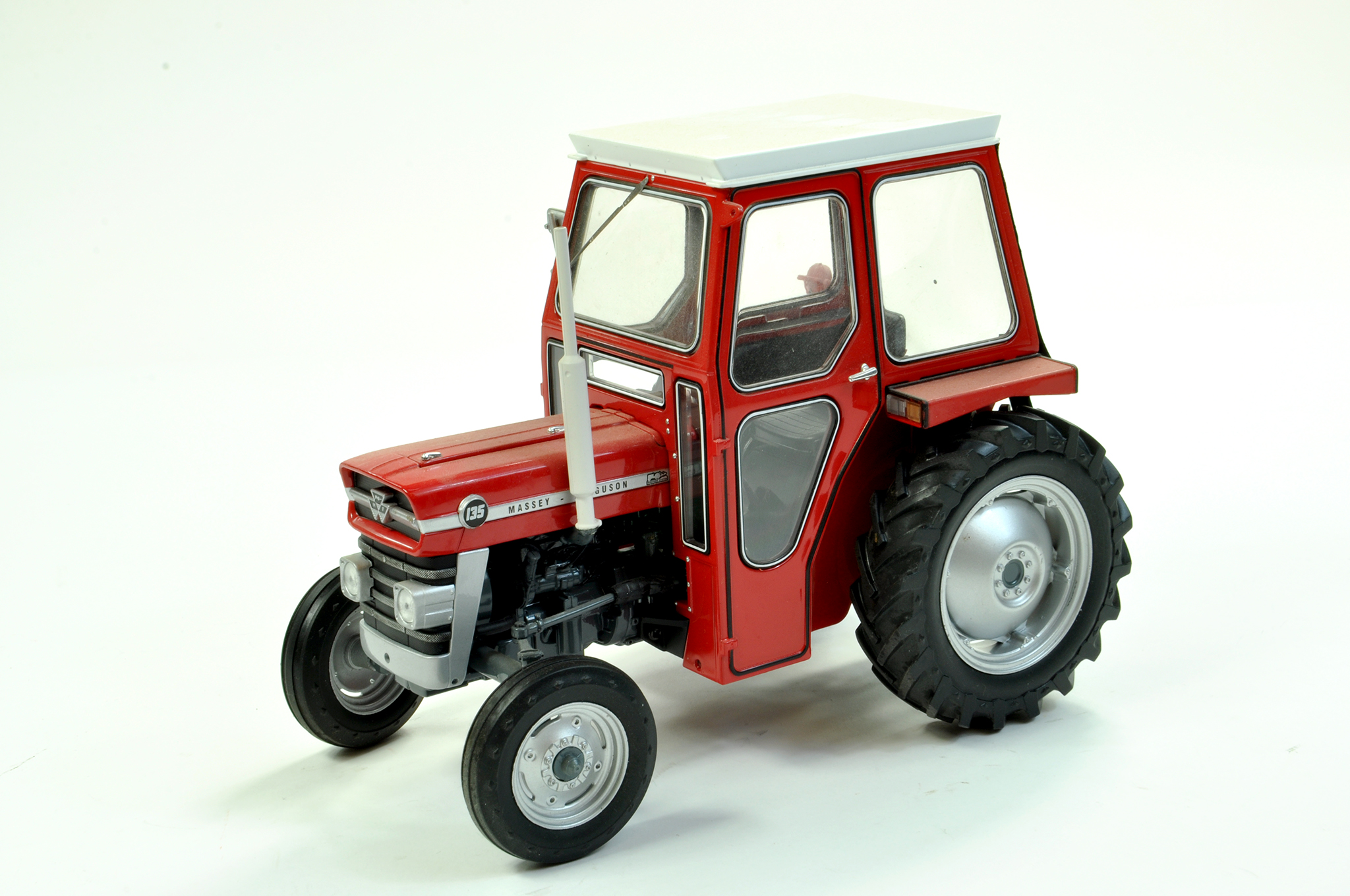 Lot 41 - Universal Hobbies 1/16 diecast farm issue comprising Massey Ferguson 135 Tractor with Cab. A
