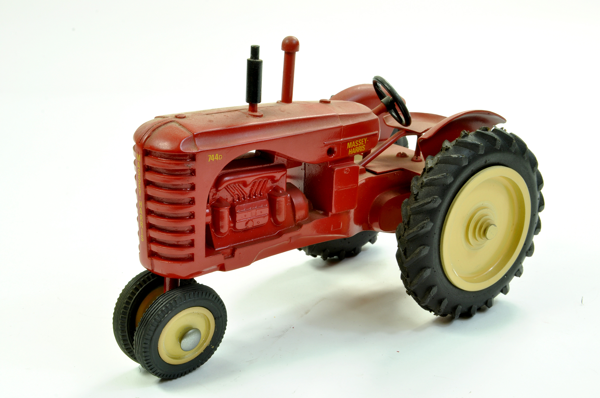 Lot 29 - Marbil Models 1/16 Massey Harris 744D Tractor on Row Crops. Generally Excellent, a little dusty.