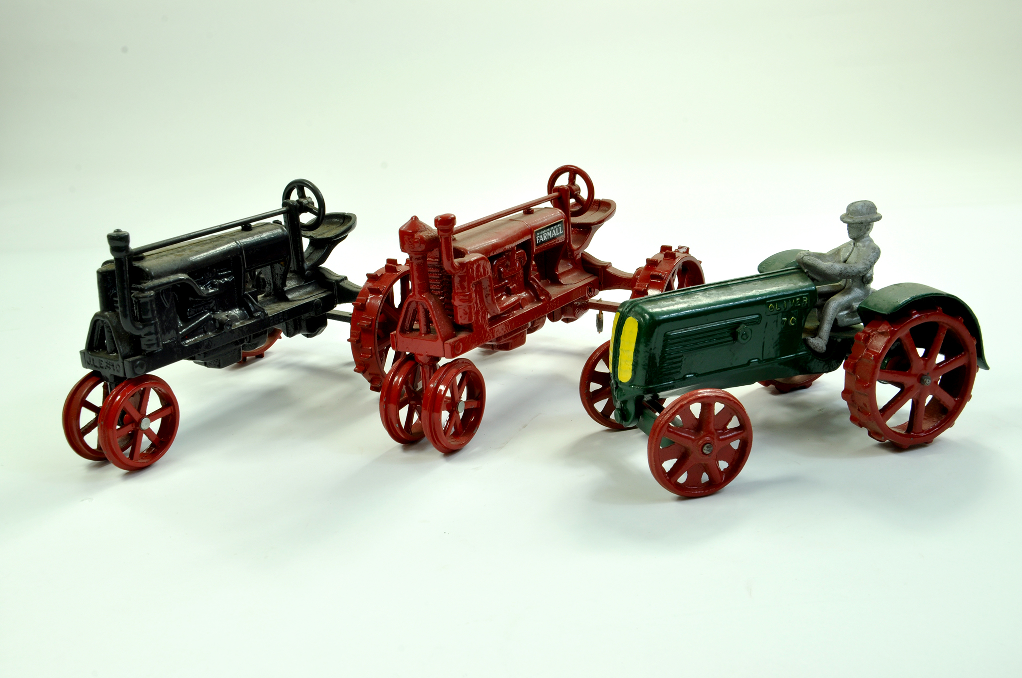 Lot 14 - Scale Models 1/16 diecast duo comprising Farmall McCormick Tractor issues plus a heavy cast Oliver