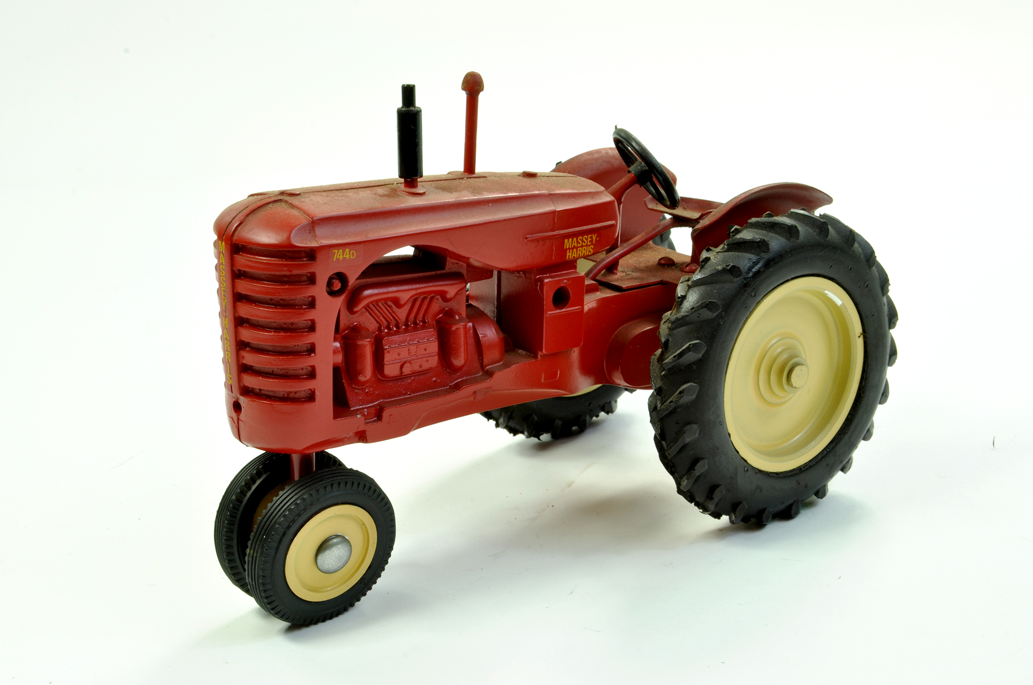 Lot 34 - Marbil Models 1/16 Massey Harris 744D Tractor on Row Crops. Generally Excellent, a little dusty.