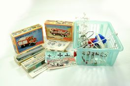 A misc toy group comprising duo of model kits, complete plus Airfix Lotus header card and other