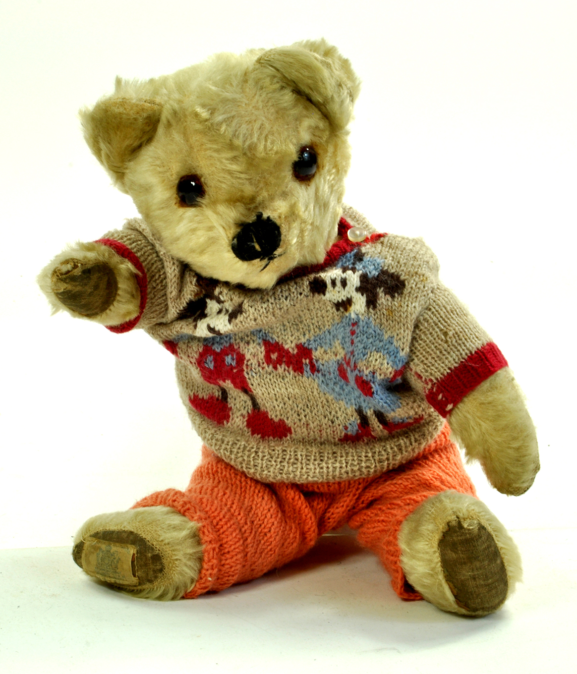 A splendid, Chad Valley Bear (with label) dressed in delightful hand made clothing. Handome chap.