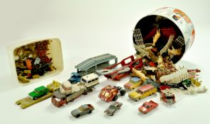 An assortment of diecast issues including some plastic figures. Mostly all play worn.  Note: We