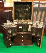 A 19th Century mahogany apothecary's cabinet with box wood stringing opening to reveal two fitted