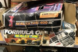 """A Scalextric 400-C589 kit (boxed) together with another """"Formula One"""" and a box of various track"""