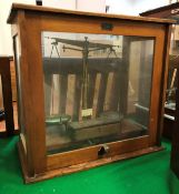 """A pair of late Victorian mahogany cased precision scales bearing label """"Townson & Mercer Ltd,"""