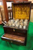 A 19th Century figured mahogany and ebony strung apothecary's chest,