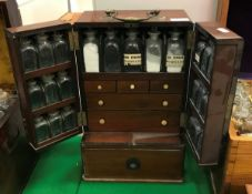 A Victorian mahogany apothecary's cabinet with brass swan-necked handle,