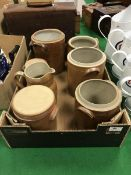 A modern French salt glazed pottery jug and six similar storage jars