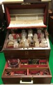 A Victorian mahogany cased apothecary's chest by Savory & Moore the rising lid with brass flush