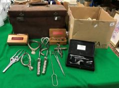 A leather-covered case containing various medical equipment/tools,