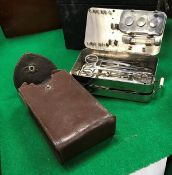 """A German World War I field surgeon's kit in leather pouch, the metal case stamped """"D.R.G.M."""