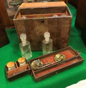 A Victorian embossed leather covered apothecary's cabinet fitted with two lift out compartments,