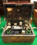 """A Victorian leather-bound travelling apothecary's chest, the top embossed """"S.G.L."""