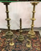 A large pair of 20th Century ecclesiastical style altar type candlesticks in the Gothic Revival